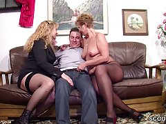 Slutty mature woman is sucking her young lover's di...