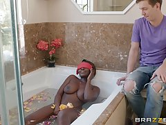 Black babe, Osa Lovely is gently rubbing her pussy in the ba...