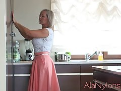 Amazing blonde granny likes to lift her skirt in front of th...