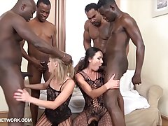 Four black guys are fucking two white sluts at the same time...
