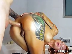 Inked milf is getting fucked from behind, in front of the ca...