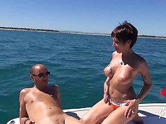 Fit, mature brunette with big tits, Carole is getting spit- ...