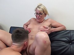 Mature blonde woman with glasses is rubbing her step- son&am...