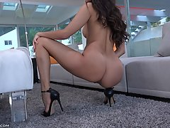 Naked teen brunette in sandals with high heels, Olive is displaying her perfectly shaved pussy