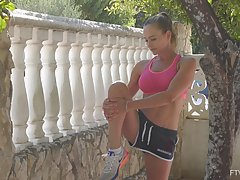 Fit teen brunette, Eve is doing her daily workout routineand...