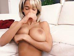 Naughty, ebony blonde with big tits, Addisson is posing nake...