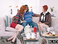 Two redheads are sharing a handsome, black guy, mostly while having casual threesomes with him
