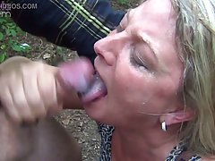 Mature, blonde woman is sucking dick in the forest and expec...