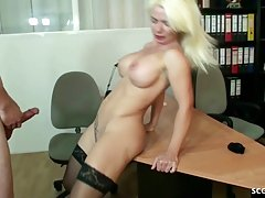 German blonde with big, firm tits is wearing black stockings...