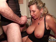 German woman in black, erotic stockings is spreading her leg...