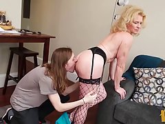 Mature blonde woman in black fishnets is about to have some ...