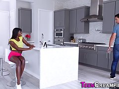 Beautiful, ebony babe is giving a blowjob to a white guy, be...