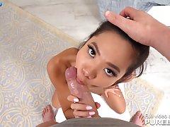 Худенькая азиатка разделась до гола и делает любовнику минет...