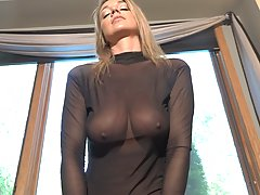 Astonishing blonde with big, firm tits is wearing a black, s...