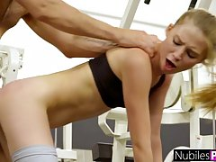 Slim blonde is doing her workout routine and having casual s...