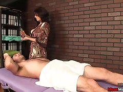 Seductive brunette masseuse with big boobs is often giving handjobs to her clients, for tips