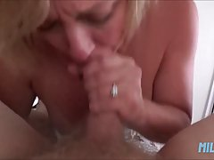 Busty blonde mature is sucking a younger guy's rock...