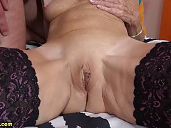 Insatiable blonde granny in erotic, black stockings likes to...
