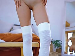Sweet, all- natural blonde in white lingerie and stockings i...