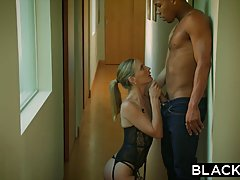 Classy, blonde woman in erotic lingerie and her husband's friend are about to have casual sex