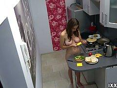 Lovely teen brunette likes to be completely naked in the kit...