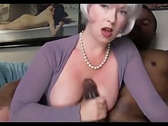 Hot blonde woman with big, firm tits is doing it with a hand...