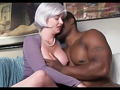 Hot blonde woman with big, firm tits is doing it with a handsome, black guy