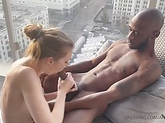 Handsome, black guy is fucking a smoking hot, white girl  on the balcony, in the afternoon