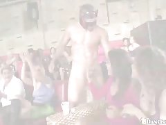 A large group of insatiable girls is partying and sucking a handsome dancer's dick, like sluts