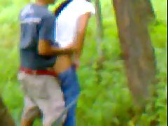 Indian couple is doing it in a local forest, although someone might be watching them in action
