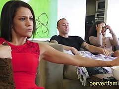 Babe in red is watching her favorite series while her partner is getting a nice blowjob