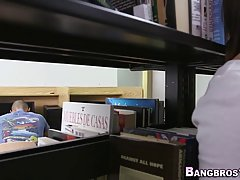 An amateur girl in a flower printed skirt is sucking dick and getting fucked in the library