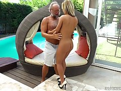 Hot woman in shoes with high heels is having casual sex with an elderly guy