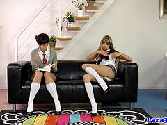 Two naughty schoolgirls decided to make love with each other and then a hot milf joined their party