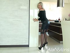 Great looking blonde granny is posing in her daily outfit an...